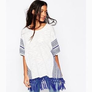 Poncho with short sleeves
